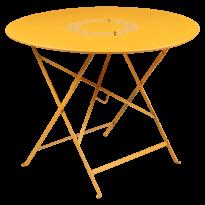 Table pliante ronde LORETTE de Fermob, Miel, D. 96